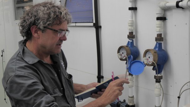 Tim Miller checks the calibration on of water meters on a Midlands pig farm.