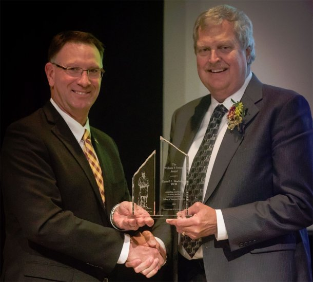 (Left to right) Dan Grooms, Ph.D., dean of the Iowa State University College of Veterinary Medicine, presents Darrell Neuberger, DVM, Tonisity technical services veterinarian, with the 2018 William P. Switzer Award in Veterinary Medicine for his contributions to society and to the college. (Photo credit: Iowa State University)
