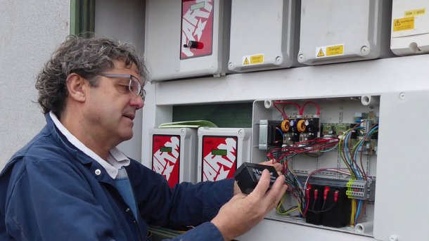 Tim Miller checks a fail-safe battery on a 400-pig place finishing building on a Midlands farm.