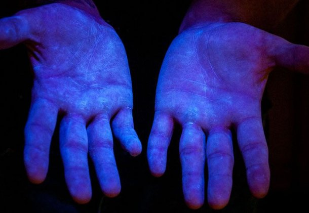 Picture 6. Fluoresce material under UV light to demonstrate coverage in human hands. Source www.glogerm.com