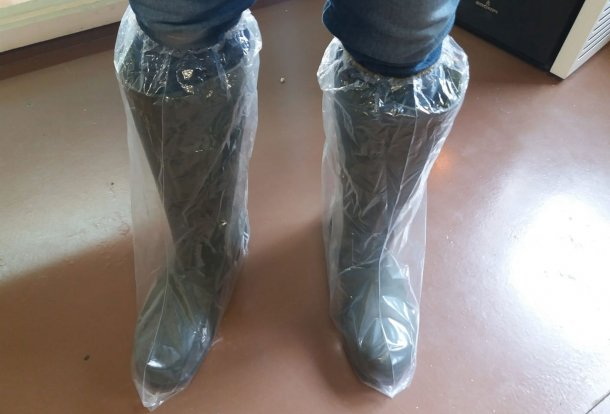 Picture 1. Plastic boots help prevent cross contamination by footwear.
