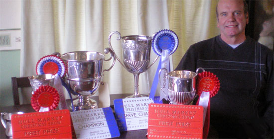 Ian Broumpton with the haul of silverware which he  won at Hull Market Christmas Fatstock Show