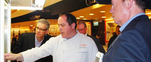 Timothy Broderick, executive chef at the Great Food Hall in Hong Kong, discusses meat selections with Joel Haggard (left), USMEF Senior VP for the Asia Pacific region, Nebraska Beef Council Member Chris Abbott (right) and Illinois Soybean Association board member Mark Sprague