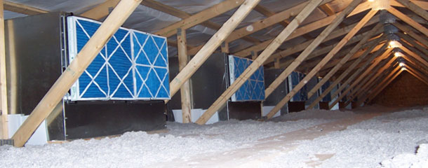 Image of the attic with filter boxes in a sows' farm adapted to the air filtering system.