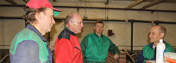 Hugh Crabtree  (2nd left) discusses the finer points of ventilation with producers on a Finnish pig farm.