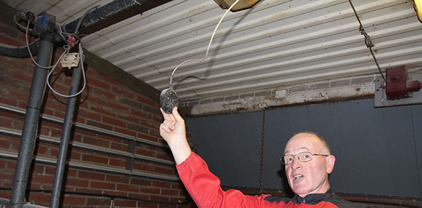 Hugh Crabtree demonstrates the best position of a temperature control sensor — particularly critical with extremes of temperature. The horizontal pipes on the wall carry hot water — necessary to counteract the severe Finnish winters.